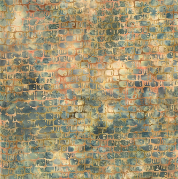 Basket weave pattern batik fabric in golden yellows and oranges with a cream and dusty blue mottled background.