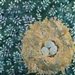 Quilt block of a bird nest with three blue eggs