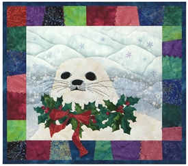 This little seal is decked out in a holly wreath and ready for Christmas!