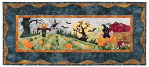 Kitten at the pumpkin patch, popping out of a pumpkin filled with candy. There is a scarecrow in the field and a spooky tree in the background under a harvest moon