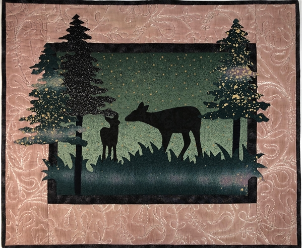 A pair of quilt blocks, one at dusk and one at dawn of a family of deer