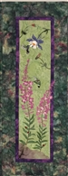 Quilt block of the wildflowers Fireweed and Columbine, being visited by hummingbirds.