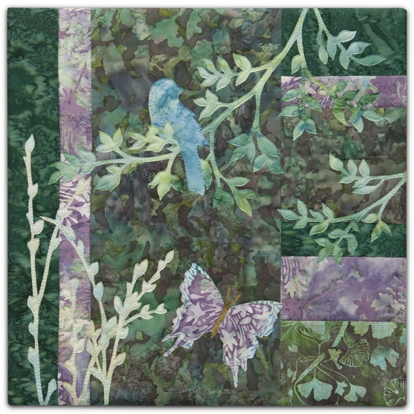 Quilt block with stylized bird on a tree branch in purple and green floral patterns