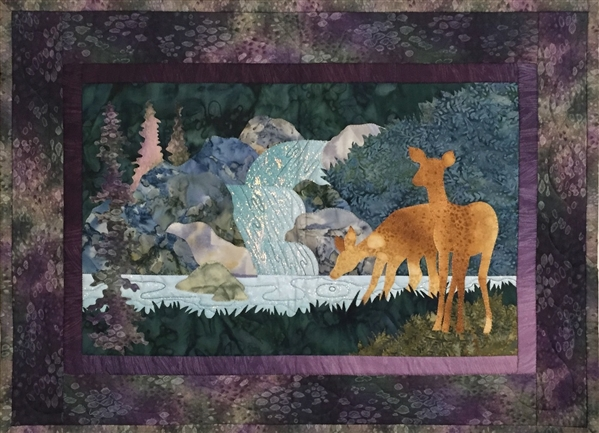 Quilt block of a doe with her fawn carefully drinking from the stream below a small waterfall.