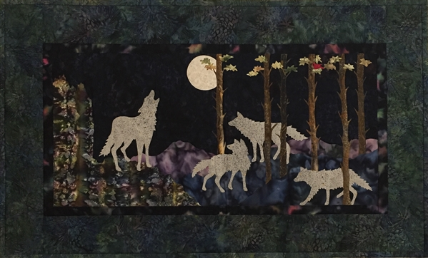 A wolf pack hunts by the light of the full moon.