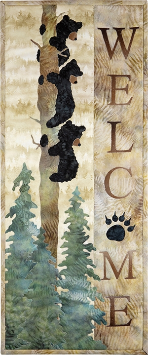 Three Bears hanging to a tree trunk overlook the words Welcome, a perfect quilt block for a cabin or woodland retreat