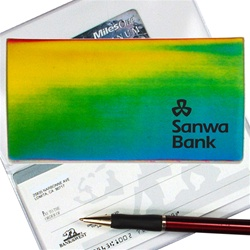 Lenticular checkbook cover with yellow, blue, and green, color changing with