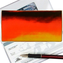 Lenticular checkbook cover with brown, yellow, and orange, color changing with