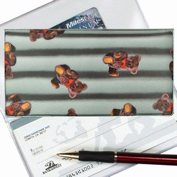 Lenticular checkbook cover with teddy bears on a black and white striped background, depth