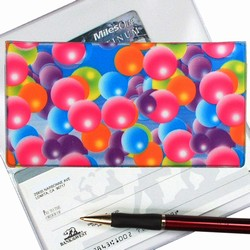 Lenticular checkbook cover with pink, blue, orange, and green bubbles, depth