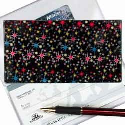 Lenticular checkbook cover with outer space stars and planets on a deep black background, depth