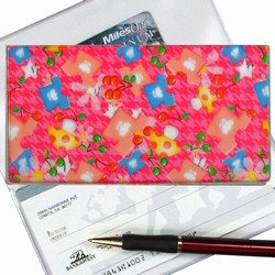 Lenticular checkbook cover with mushrooms, t-shirts, and stars on a pink background, depth