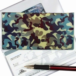 Lenticular checkbook cover with camouflage of blue, black, and silver, color changing