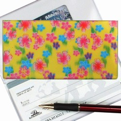 Lenticular checkbook cover with pink, blue, and green flowers on a yellow background, depth