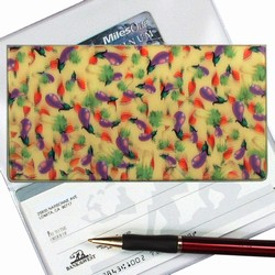 Lenticular checkbook cover with purple egg plant with green and red leaves on a yellow background, depth