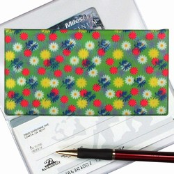 Lenticular checkbook cover with yellow, pink, and white flowers on a green background, depth