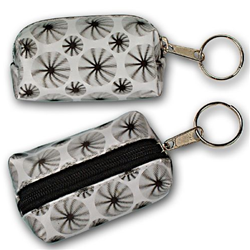 Lenticular purse key chain with black spinning wheels on white background, animation