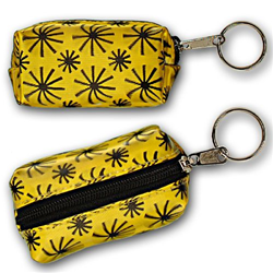 Lenticular purse key chain with black spinning wheels on yellow background, animation