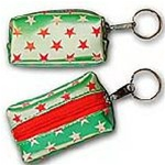 Lenticular purse key chain with white and red stars on a green background, color changing flip