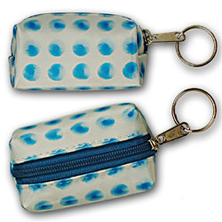 Lenticular purse key chain with blue circles spin around on a white background, animation