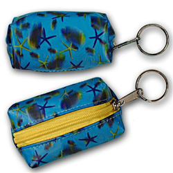 Lenticular purse key chain with sea stars, fish, and sea shells on a light blue background, depth