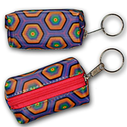 Lenticular purse key chain with kaleidoscope colored hexagons on a purple background, color changing