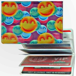 Lenticular credit card ID holder with large orange, green, and blue happy faces, depth