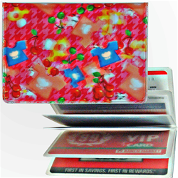 Lenticular credit card ID holder with mushrooms, stars and t-shirts on a pink background, depth