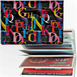 Lenticular credit card ID holder with rainbow alphabet letters on black background, depth