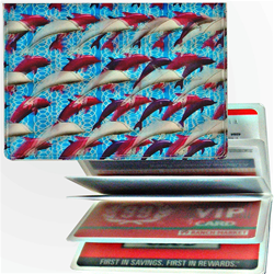 Lenticular credit card ID holder with purple and white dolphins on a blue background, depth