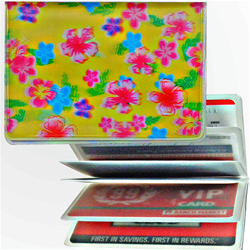 Lenticular credit card ID holder with pink, blue, and green flowers on a yellow background, depth