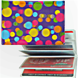 Lenticular credit card ID holder with pink, yellow, blue, and green balls on a purple background, depth