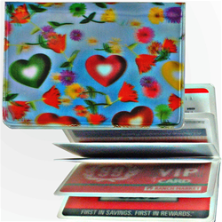 Lenticular credit card ID holder with multi colored hearts and flowers on a sky blue background, depth