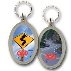 Lenticular acrylic key chain with oval shaped, custom design, AAA curvy road sign on a cloudy sky, flip