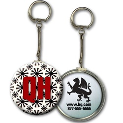 Lenticular key chain with black spinning wheels on white background, animation