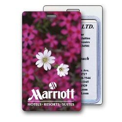 Lenticular luggage tag with bed of pink flowers inside a beautiful spring garden, depth