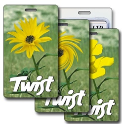 Lenticular luggage tag with yellow flower in a green field Printing