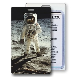 Lenticular luggage tag with NASA explorer astronaut stands on grey dusty Moon in outer space, depth