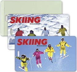 Lenticular luggage tag with orange and yellow snow skiiers jump off a mountain, flip