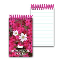 Lenticular mini notebook with bed of pink flowers inside a beautiful spring garden, depth