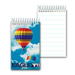 Lenticular mini notebook with rainbow striped hot air balloon and parachute in cloudy summer sky, depth