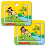 Lenticular paper clip with cute tropical Hawaiian hula girl dancing in front of a straw hut and palm tree, flip