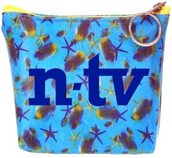 Lenticular zipper purse with sea stars, fish, and sea shells on a light blue background, depth