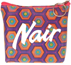 Lenticular zipper purse with kaleidoscope colored hexagons on a purple background, color changing