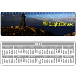 Lenticular ruler with lighthouse on a peninsula, casting a blinding light across the night sky onto the ocean for ship naviation, animation
