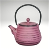 "Image of the ""Nabe"" cast iron teapot by Ja by Frieling. This teapot has a lavender exterior with a textured surface."