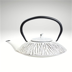 "Image of the ""Shimauma"" cast iron teapot by Ja by Frieling. This teapot has a textured and handpainted exterior in a zebra pattern. The image shows the black handle."