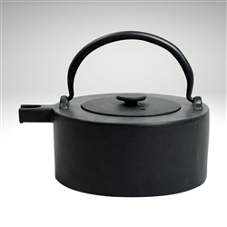 "Image of the ""Tawa"" cast iron teapot by Ja by Frieling. This teapot has a black exterior and a black matching lid. The image shows the black handle."