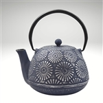 "Image of the ""Hani"" cast iron teapot by Ja by Frieling. This teapot has a navy blue cast iron exterior with hand painted textured silver flower prints as a decorative surface."