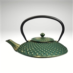 "Image of the ""Kambin"" cast iron teapot by Ja by Frieling. This teapot has a textured and handpainted exterior in a gold polka dot pattern, over a deep green base."